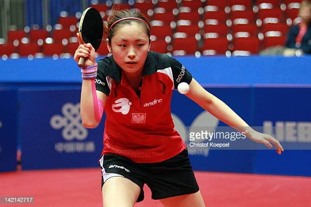 Li Qian of Poland plays a forehand during her match against Guo Yue of China during the LIEBHERR table tennis team world cup 2012 championship...