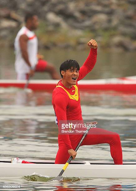 Li Qiang of China celebrates claiming the Gold medal in the Men's C1 200m Final during day ten of the 2014 Asian Games at Hanam Misari Canoe/Kayak...