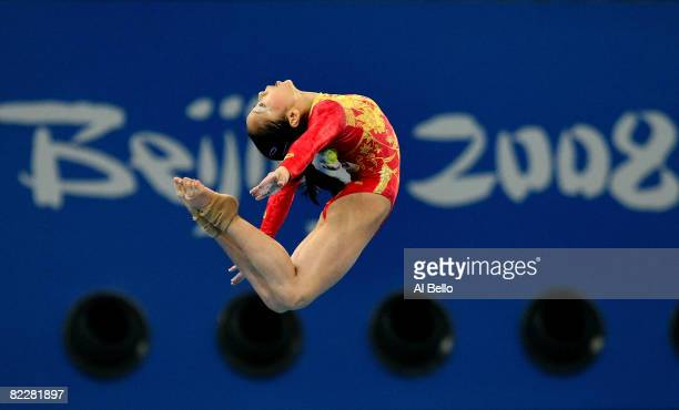 Li Shanshan of China performs on the balance beam during the women's team final of the artistic gymnastics event at the National Indoor Stadium...