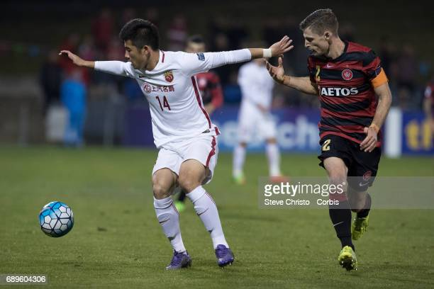 Li Shenglong of Shanghai battles for the ball with Wanderers Shannon Cole during the AFC Asian Champions League Group Stage match between the Western...