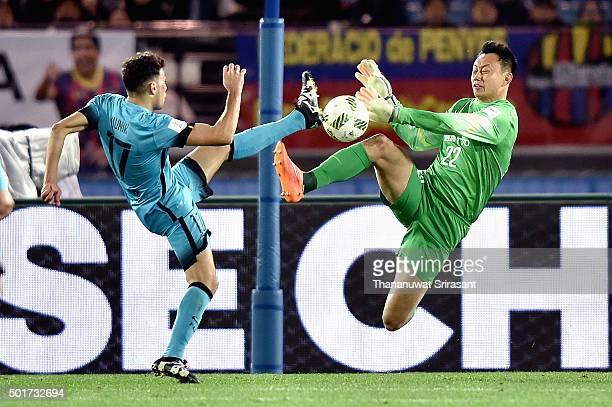 Li Shuai of Guangzhou Evergrande and Munir El Haddadi of Barcelona competes for the ball during the FIFA Club World Cup Semi Final match between...