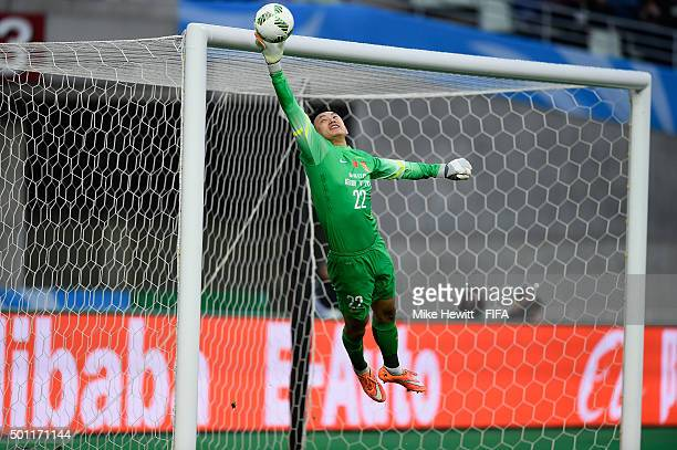Li Shuai of Guangzhou Evergrande makes a fine save from a free kick by Paolo Goltz of America during the FIFA Club World Cup Japan 2015 quarter final...