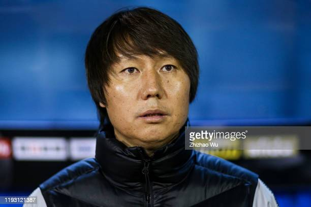 Li Tie coach of China looks on during the EAFF E-1 Football Championship match between China and Japan at Busan Gudeok Stadium on December 10, 2019...