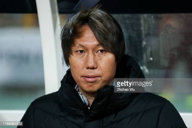 Li Tie coach of China looks on during the EAFF E-1 Football Championship match between South Korea and China at Busan Asiad Main Stadium on December...