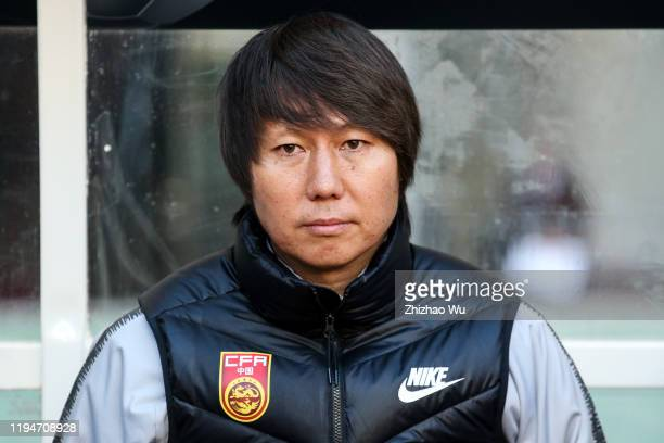 Li Tie coach of China looks on during the EAFF E-1 Football Championship match between Hong Kong and China at Busan Asiad Main Stadium on December...
