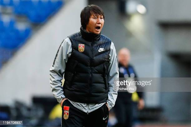 Li Tie coach of China reacts during the EAFF E-1 Football Championship match between Hong Kong and China at Busan Asiad Main Stadium on December 18,...