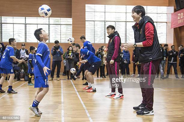 Li Tie of China attends the campus activities of 2017 Gree China Cup International Football Championship on January 12, 2017 in Nanning, Guangxi...