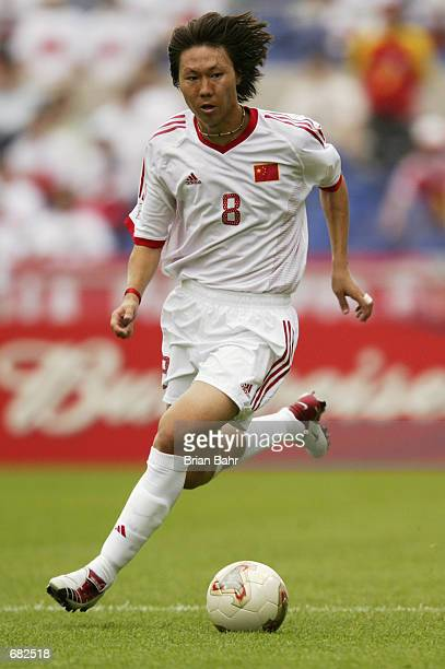 Li Tie of China runs with the ball during the FIFA World Cup Finals 2002 Group C match between China and Costa Rica played at the Gwangju World Cup...