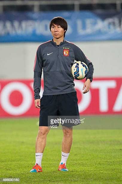 Li Tie of Guangzhou Evergrande Taobao Football Club warms up before the AFC Asian Champions League match between the Guangzhou Evergrande and Kashima...