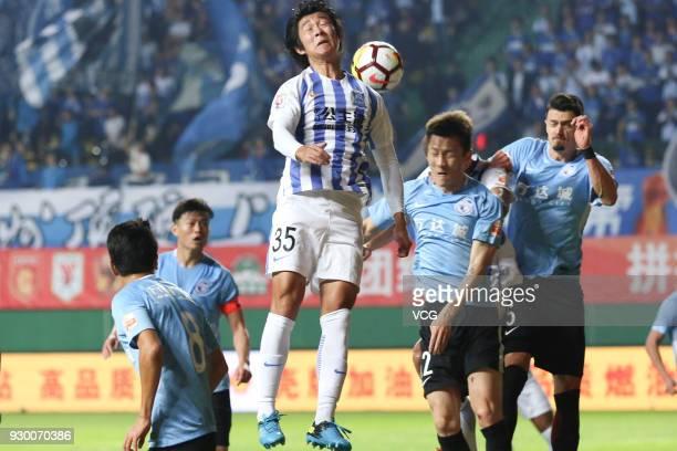 Li Tixiang of Guangzhou RF heads the ball during the 2018 Chinese Football Association Super League second round match between Guangzhou RF and...