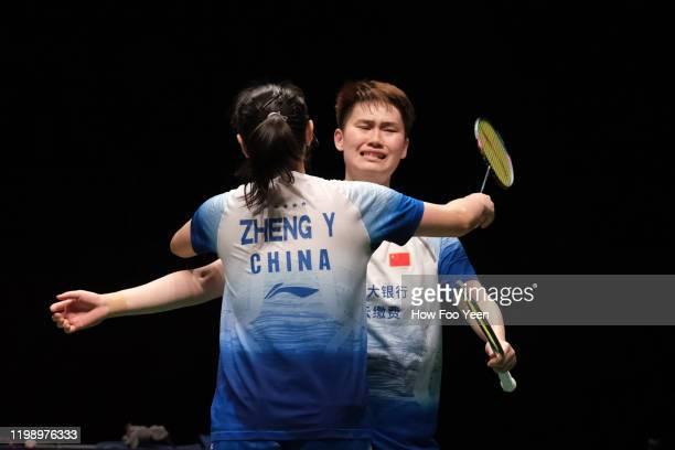 Li Wen Mei and Zheng Yu of China celebrate after defeating Du Yue and Li Yin Hui of China during the women doubles finals at the Perodua Malaysia...