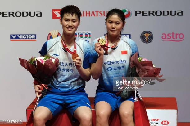 Li Wen Mei and Zheng Yu of China poses with their medals after defeating Du Yue and Li Yin Hui of China during the women doubles finals at the...
