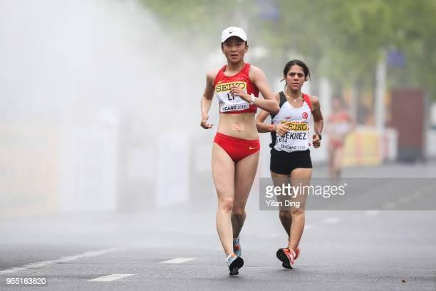 Li Wenxiu of China and Meryem Bekmez of Turkey in action during Women's 10 kilometres Race Walk of IAAF World Race Walking Team Championships Taicang...