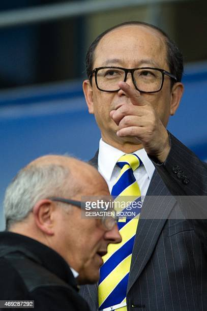 Li Wing-Sang, CEO of Hong-Kong based lighting company Ledus, gestures before the French L2 football match Sochaux vs Creteil on April 10, 2015 at the...