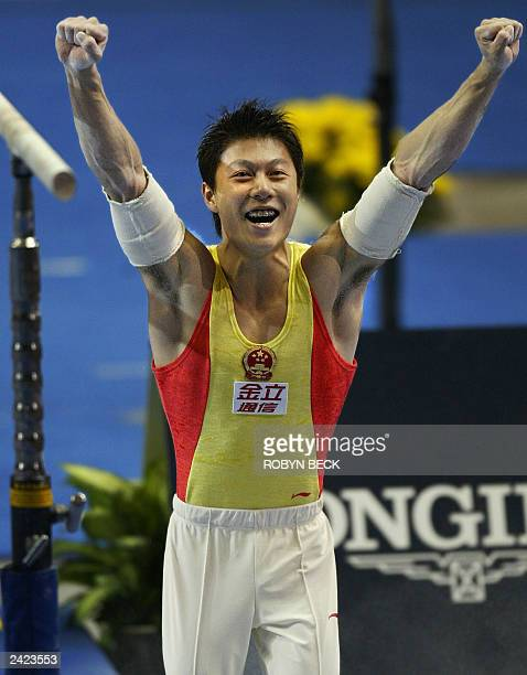 Li Xiao Peng of China celebrates at the end of his parallel bars performance to win gold in the parallel bars men's apparatus finals at the World...