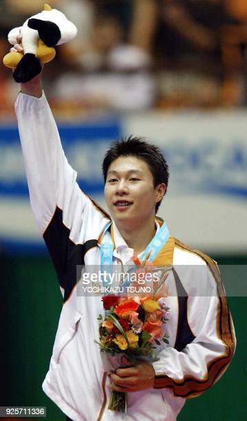 Li Xiaopeng of China celebrates after receiving his medal for the vault event during the men's apparatus finals for the 14th Asian Games in Busan 05...