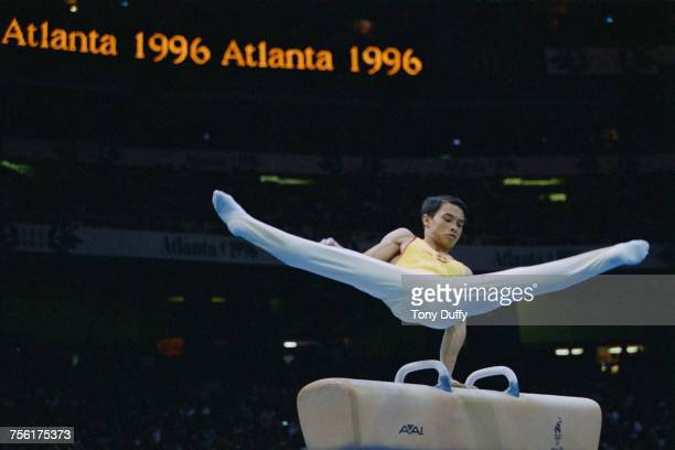 Li Xiaoshuang of China performs his routine during the Men's artistic individual allaround competition of the XXVI Summer Olympic Games on 24 July...