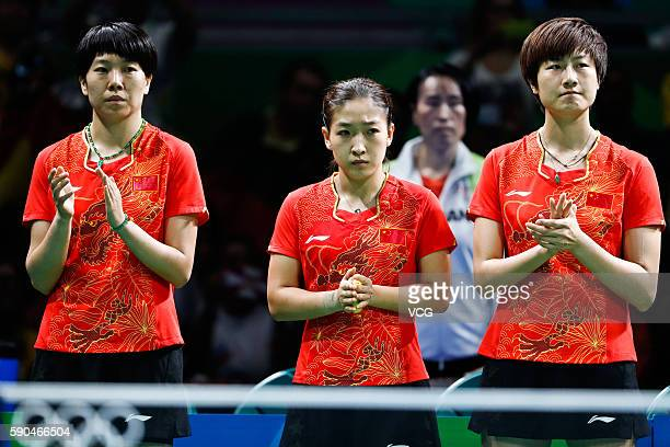 Li Xiaoxia Liu Shiwen and Ding Ning of China line up for the Women's Team Gold Medal Team Match between China and Germany on Day 11 of the Rio 2016...
