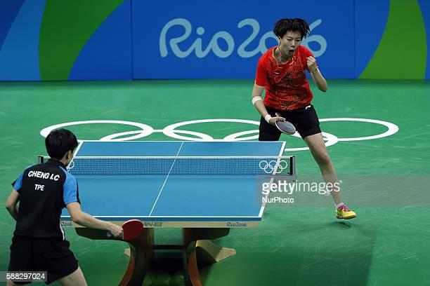 Li Xiaoxia of China celebrates scoring during the women's singles quarterfinal of table tennis between Li Xiaoxia of Chian and Cheng IChing of...