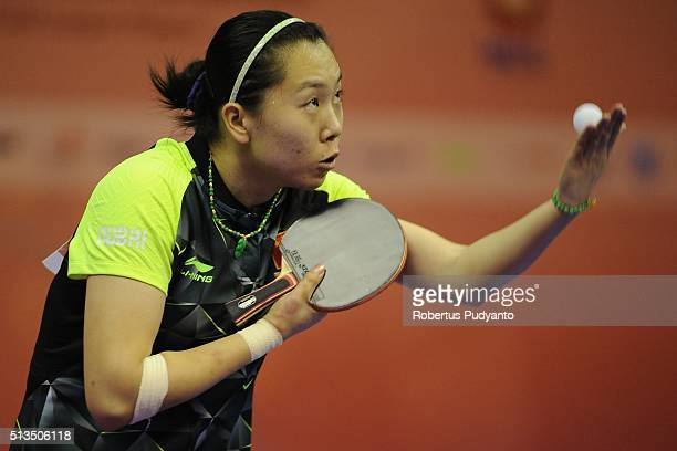 Li Xiaoxia of China competes against Britt Eerland of Netherlands during the 2016 World Table Tennis Championship Women's Team Division quarterfinal...