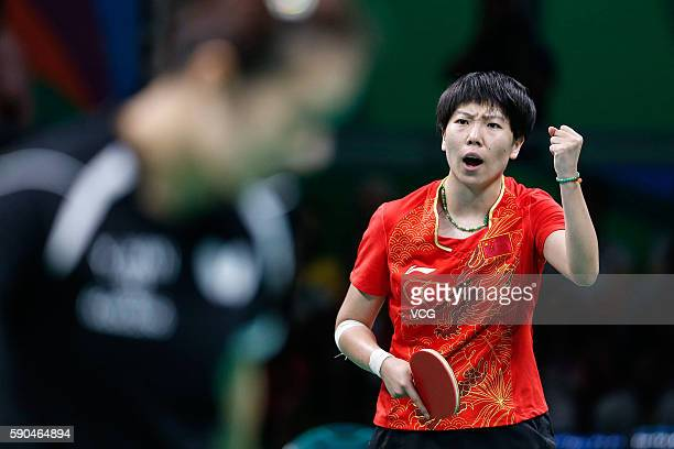 Li Xiaoxia of China competes against Han Ying of Germany in the Women's Team Gold Medal Team Match between China and Germany on Day 11 of the Rio...