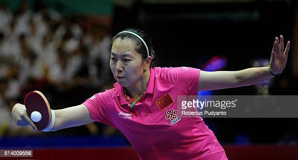 Li Xiaoxia of China competes against Kasumi Ishikawa of Japan during the 2016 World Table Tennis Championship Women's Team Division final match at...