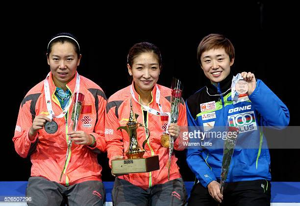 Li Xiaoxia of China Liu Shiwen and Feng Tianwei of Singapore pose on the podium after the Women's singles final of the Nakheel Table Tennis Asian Cup...