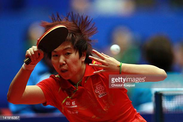Li Xiaoxia of China plays a forehand during her match against Tetyana Bilenko of Ukraine during the LIEBHERR table tennis team world cup 2012...