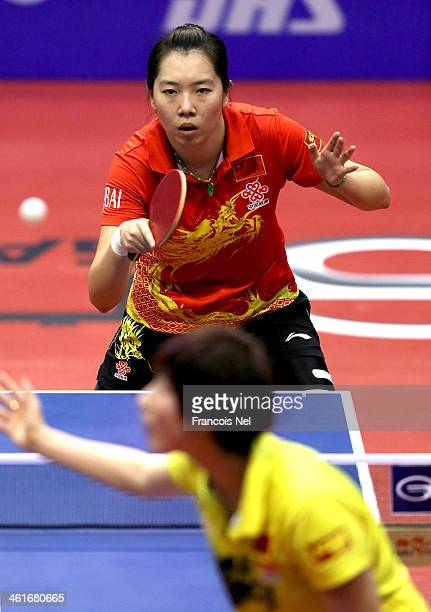 Li Xiaoxia of China plays against Ding Ning of China in the semi finals of the Women's singles during the GAC Group 2013 ITTF World Tour Grand Finals...