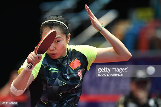 Li Xiaoxia of China returns the ball during the women's singles final match against Ishikawa Kasumi of Japan at the Asian Table Tennis Qualification...