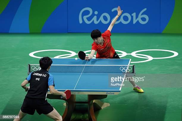 Li Xiaoxia of China returns the ball during the women's singles quarterfinal of table tennis between Li Xiaoxia of Chian and Cheng IChing of Chinese...