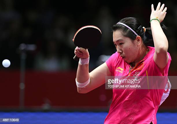 Li Xiaoxia of China returns the ball to Feng Tianwei of Singapore during their women's singles semi-final match of the 2014 World Team Table Tennis...