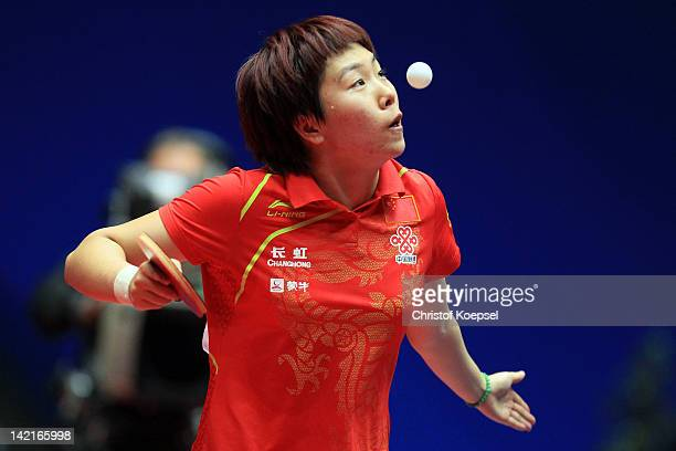 Li Xiaoxia of China serves during her match against Tie Yana of Hongkong during the LIEBHERR table tennis team world cup 2012 championship division...