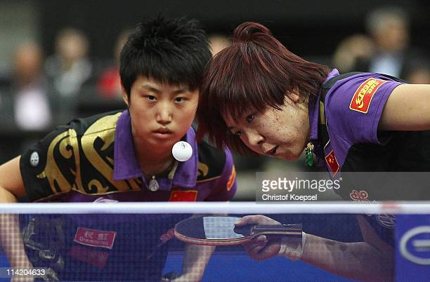 Li Xiaoxia serves with Guo Yue in action during the Women's Double Final match between Guo Yue and Li Xiaoxia of China and Ding Ning and Guo Yan of...