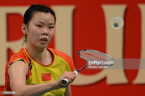 Li Xuerui of China returns the shuttle cock against Juliane Schenk of Germany during the women's single finals at the Djarum Indonesia Open 2013 at...