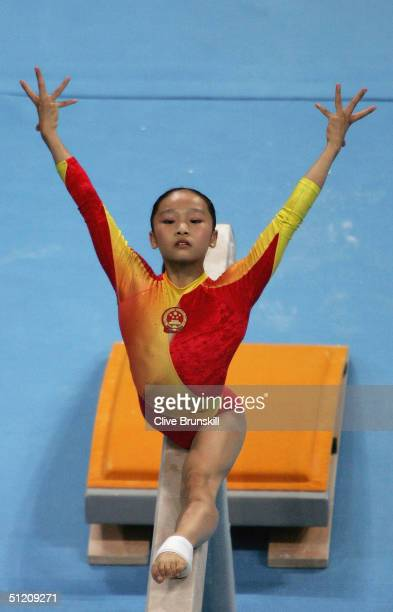 Li Ya of China poses poses during her performance in the women's artistic gymnastics balance beam finals on August 23 2004 during the Athens 2004...