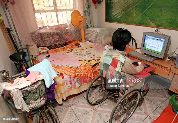 Li Yan sits in front of her computer in her home on May 7 2007 in Yinchuan Ningxia Province China Li Yan spends up to 10 hours per day in front of...