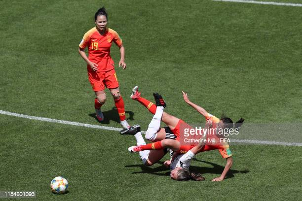 Li Yang of China clashes with Melanie Leupolz of Germany during the 2019 FIFA Women's World Cup France group B match between Germany and China PR at...