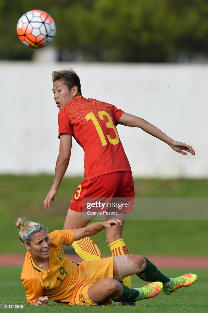 Li Yang of China competes for the ball with Katrina Gorry of Australia during the Women's Algarve Cup Tournament match between China and Australia at Municipal de Albufeira on March 6, 2017 in Albufeira, Portugal.