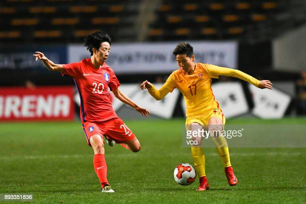Li Ying of China and Kim Hyeri of South Korea compete for the ball during the EAFF E1 Women's Football Championship between South Korea and China at...