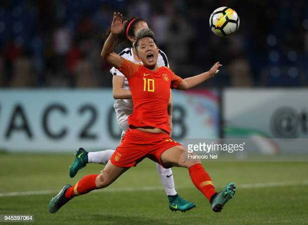 Li Ying of China and Yasmeen Khair of Jordan battle for the ball during the AFC Women's Asian Cup Group A match between Jordan and China at the Amman...