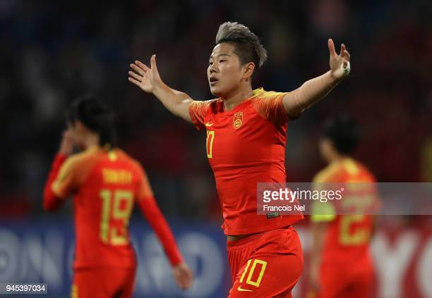Li Ying of China celebrates scoring the fifth goal during the AFC Women's Asian Cup Group A match between Jordan and China at the Amman International...