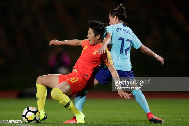 Li Ying of China Women, Merel van Dongen of Holland Women during the Algarve Cup Women match between China PR v Holland at the Estadio Municipal de...