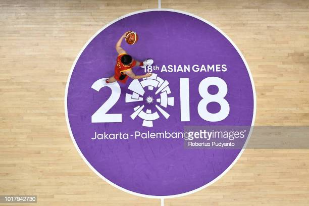 Li Yuan of China dribbles during the WomenÕs Basketball Preliminary round between Japan and China in the Asian Games 2018 at Hall A Gelora Bung Karno...