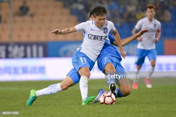 Li Yuanyi of Tianjin Teda and Eran Zehavi of Guangzhou RF compete for the ball during 2017 Chinese Super League 14th round match between Tianjin Teda...