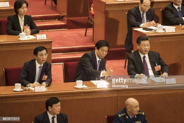 Li Zhanshu member of the Communist Party of China's Politburo Standing Committee second row center gestures as Xi Jinping China's president second...