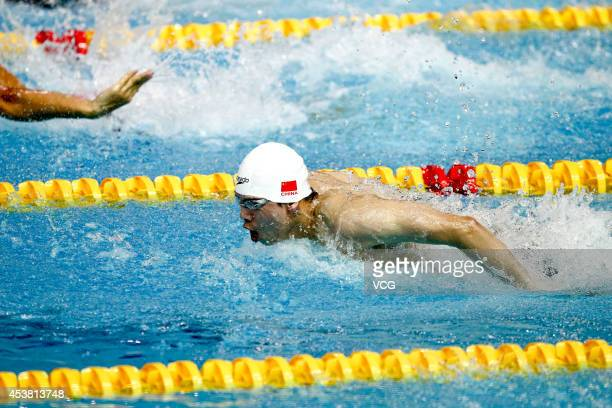 Li Zhuhao of China competes in the Men's 100m Butterfly final match on day three of the Nanjing 2014 Summer Youth Olympic Games at Nanjing OSC...