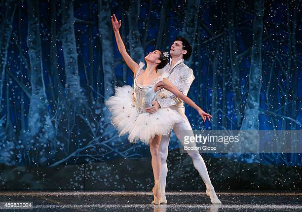 Lia Cirio left and Lasha Khozashvili right perform during Boston Ballet's dress rehearsal for The Nutcracker at the Boston Opera House in Boston on...