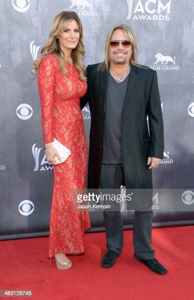 Lia Geraldini and recording artist Vince Neil attend the 49th Annual Academy Of Country Music Awards at the MGM Grand Garden Arena on April 6 2014 in...