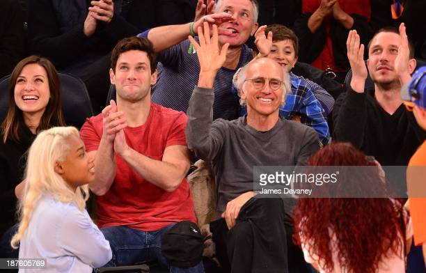 Lia Smith Justin Bartha Larry David and guest attend the San Antonio Spurs vs New York Knicks game at Madison Square Garden on November 10 2013 in...